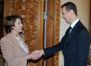 Syrian President Bashar al-Assad shakes hands with U.S. House Speaker Nancy Pelosi in Damascus